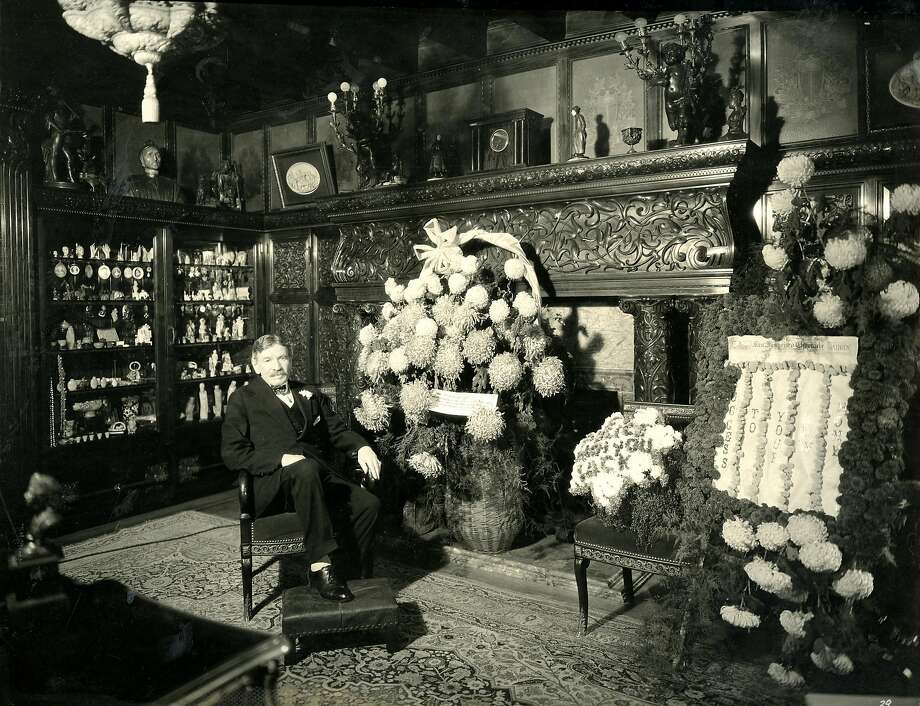 M.H. de Young, proprietor and publisher of the Chronicle, in his famous office, in the new San Francisco  Chronicle building at 5th and Mission streets in 1924. He is seated with congratulatory flowers presented to him by Chronicle employees and civic organizations.De Young's office appears precisely as it did in the old location at Market and Kearny streets. All of the beautiful woodwork and fittings of his old office were moved to the new location and installed in a room built to the exact dimensions of the former one. It was said that no one could tell that it had been moved. Photo by Gabriel Moulin Studio Photo: Gabriel Moulin, Of Moulin Studios