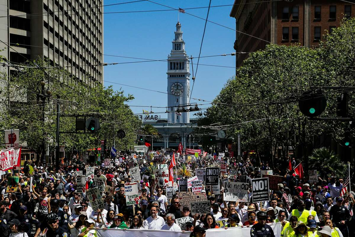 Thousands of people gather as they walk down Market Street during a May Day demonstration in San Francisco on Monday, May 1, 2017.