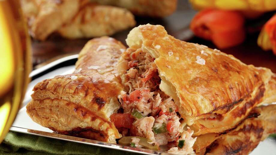 Spicy Crab and Tomato Empanadas make a filling dinner. Photo: Michael Tercha, MBR / Chicago Tribune