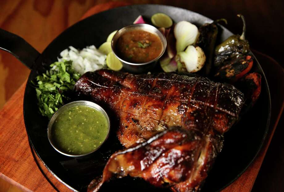 Heritage Pig's Head Carnitas - half a head of a slow-braised, milk-fed pork pig, cooked carnitas style - is among the new menu items at Goode Co.'s Armadillo Palace. Photo: Yi-Chin Lee, Staff / © 2017  Houston Chronicle