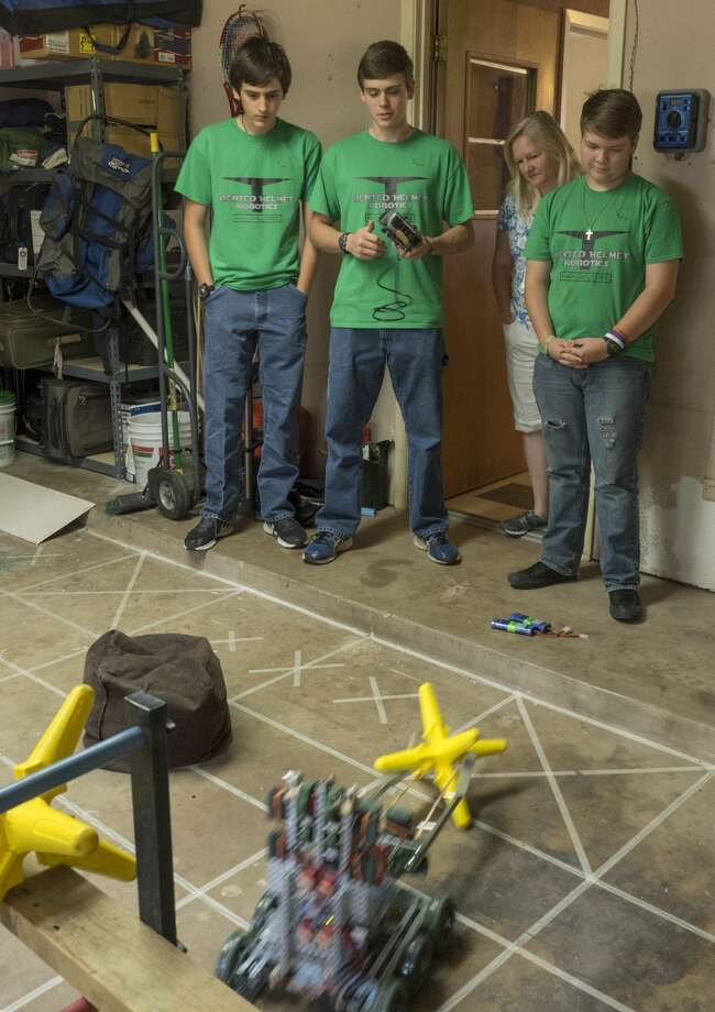 Conner Stringham, his brother Brandon, and Caleb Anderson show off their robot, Mandalore, 4/27/17 they used to compete in the World Tournament for VEX robotics. Tim Fischer/Reporter-Telegram Photo: Tim Fischer/Midland Reporter-Telegram