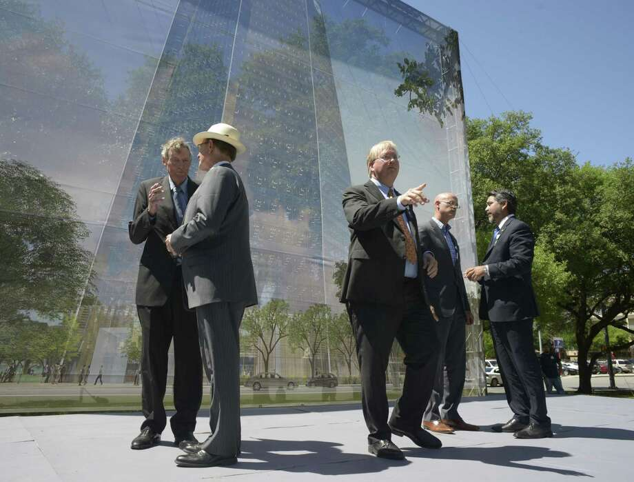Frost Tower just one way in which businesses are investing in downtown San Antonio. Local officials attend its groundbreaking in March. Photo: Billy Calzada /San Antonio Express-News / San Antonio Express-News