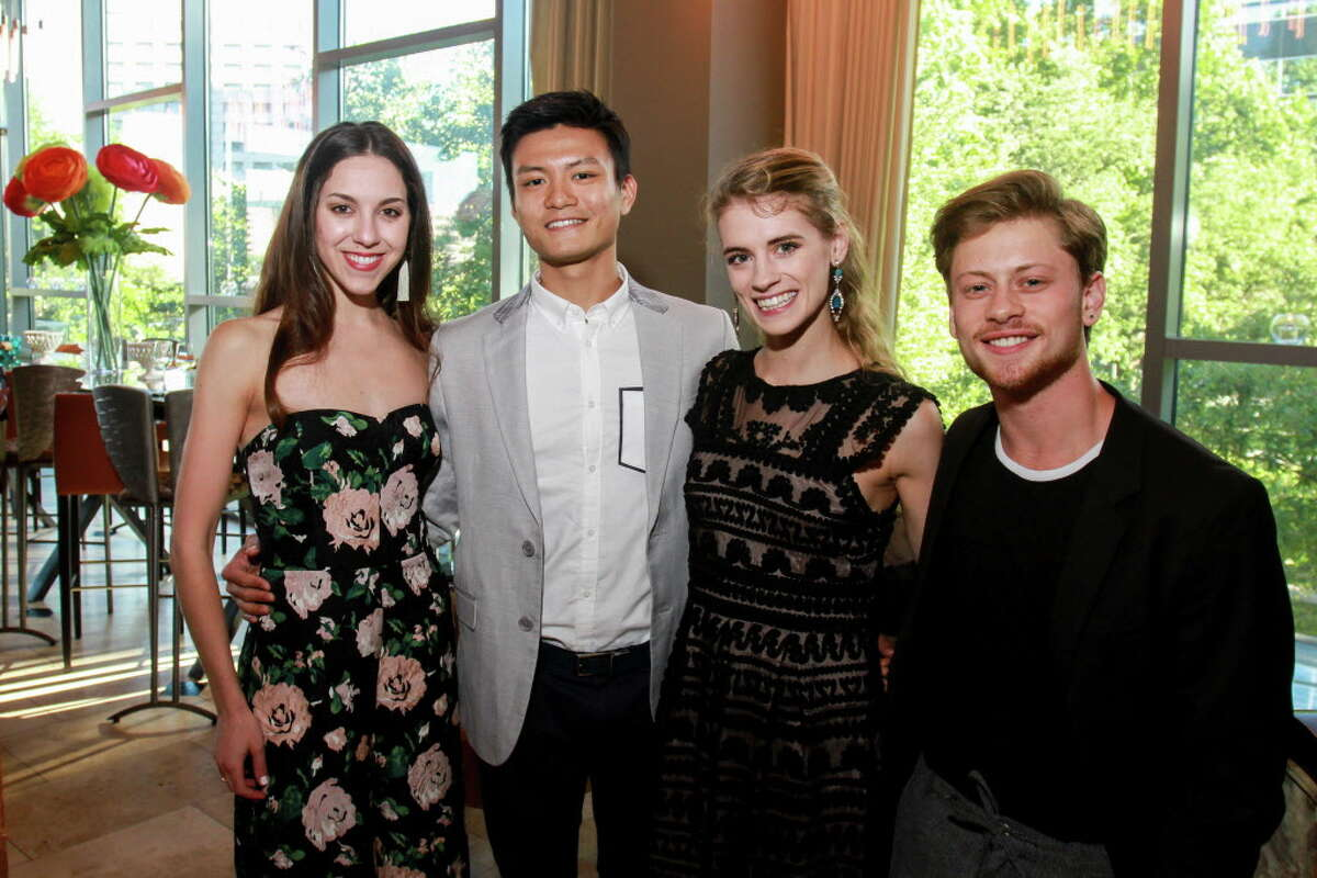Dancers Katharine Precourt, from left, Chun Wai Chan, Jacquelyn Long and Derek Dunn at the Raising the Barre dinner at Cafe Annie hosted by the Houston Ballet's young professionals group. (For the Chronicle/Gary Fountain, April 30, 2017)