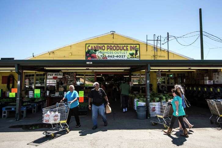 Shoppers walk outside Canino Produce Inc., Farmers Outlet in the 2500 block of Arline on Monday, May 1, 2017, in Houston. A local developer is under contract to purchase the farmer's market property in the Heights area. The group says the market will stay, but improvements are planned that will affect the property in the long term.  ( Brett Coomer / Houston Chronicle )