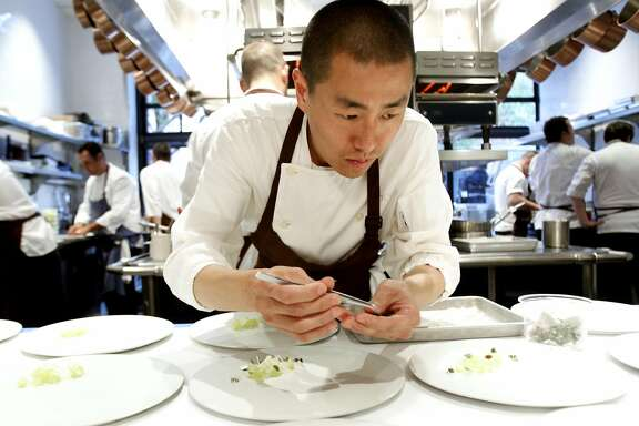 Chef Corey Lee of Benu plates a dish at the Chronicle's 4-Star Chef Dinner at Quince in San Francisco, Calif., Sunday, July 29, 2012.  The event raised money for the San Francisco/Marin Food Bank.