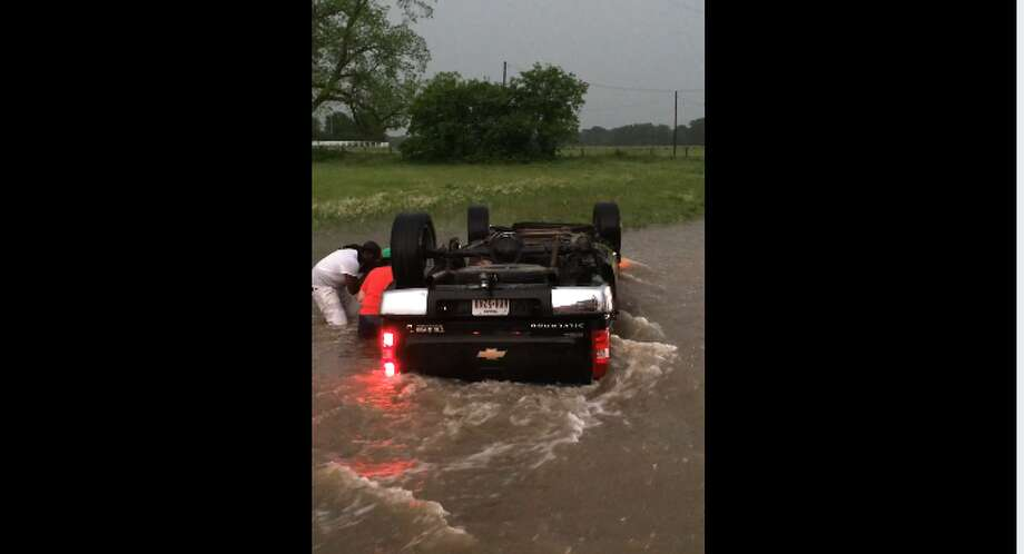 Rescue efforts that followed a series of tornadoes that struck East Texas included a group of men frantically working to pull two young children from a pickup that overturned in rushing water.