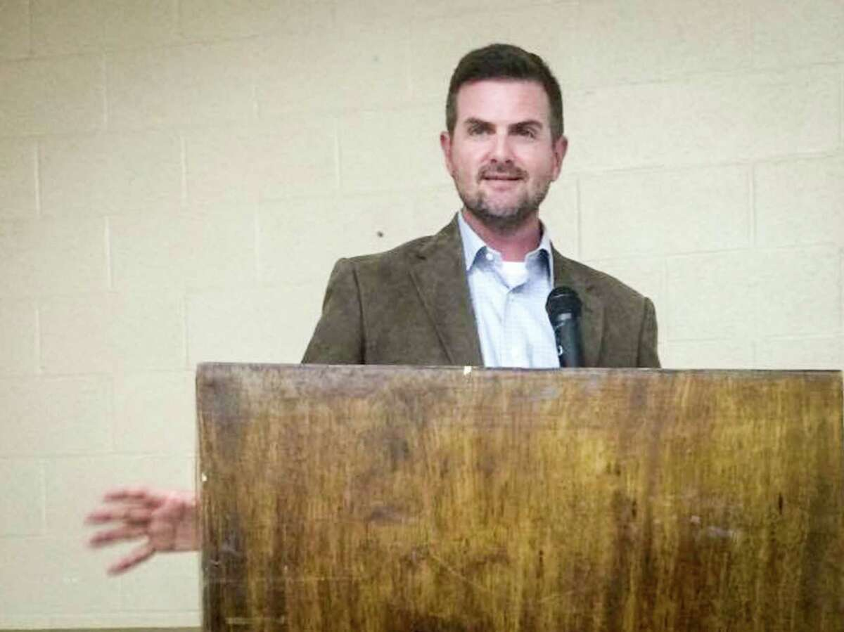 State Sen. Brandon Creighton, R-Conroe, speaks during a community meeting to discuss SB 1964 on April 9.