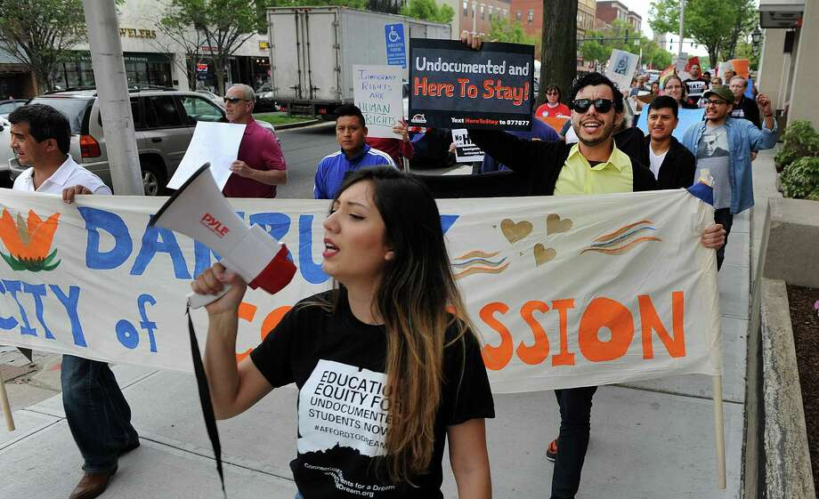 Angelica Idrovo, of Danbury, with Connecticut Students for a Dream, leads chants during a march down Main Street to Kennedy Park Monday, May 1, 2017. Danbury joins a nationwide day of action, demanding dignity and respect for immigrants, workers, and students called NO HATE IN HAT CITY: March for Immigrant Rights and Worker Rights Photo: Carol Kaliff / Hearst Connecticut Media / The News-Times