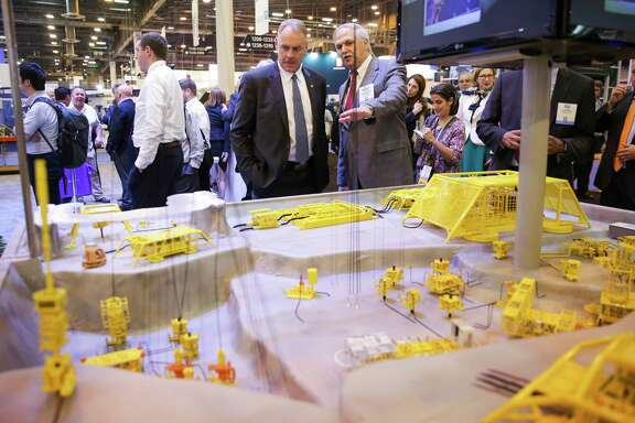 Noble Drilling Services Vice President, Marketing and Contracts Bodley Thornton, right, explains a model of a sub-sea field to US Secretary of the Interior Ryan Zinke at the Offshore Technology Conference at NRG Center Monday, May 1, 2017 in Houston. ( Michael Ciaglo / Houston Chronicle)