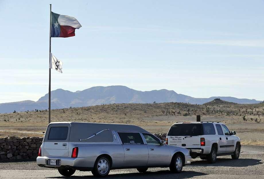 A hearse and an SUV enter the Cibolo Creek Ranch on Feb. 13, 2016 on U.S. 67 near Shafter. Photo: Edward A. Ornelas /San Antonio Express-News / © 2016 San Antonio Express-News