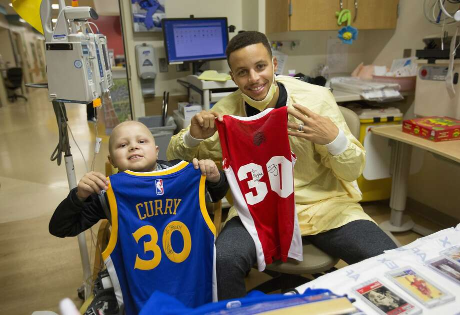 In this Nov. 20, 2016, photo provided photo by IU Health, Golden Warriors' Stephen Curry poses for a photo with Riley Patient Brody Stephens in Indianapolis. Stephens, an 8-year-old basketball-loving Indiana boy with leukemia who befriended players like Curry, has died. Brody Stephens' father told the Indianapolis Star that his son died Saturday, April 29, 2017, of a viral complication. (IU Health via AP) Photo: Chris Bergin, Associated Press