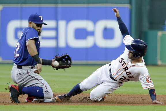 Houston Astros Jose Altuve steals second base against Texas Rangers Roughned Odor during the first inning at Minute Maid Park Monday, May 1, 2017, in Houston. ( Melissa Phillip / Houston Chronicle )