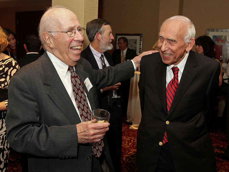 """Troy, NY - September 19, 2013 - (Photo by Joe Putrock/Special to the Times Union) - Marinstein & Marinstein's Elliott Marinstein, Esq.(left) laughs with the 2013 Edward H. """"Ebbie"""" Pattison Citezenship Award recipient Lambert Ginsberg, Esq.(right) of Pattison Sampson, Ginsberg & Griffin, PC during the Van Rensselaer Awards Dinner presented by the Rensselaer County Regional Chamber of Commerce. ORG XMIT: 08 Photo: Joe Putrock, Albany Times Union / Joe Putrock"""