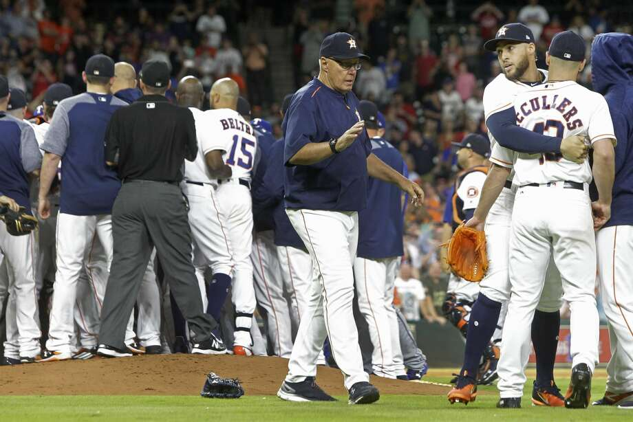 Houston Astros George Springer holds back pitcher Lance McCullers Jr. as the benches clear during the sixth inning against the Texas Rangers at Minute Maid Park Monday, May 1, 2017, in Houston. ( Melissa Phillip / Houston Chronicle ) Photo: Melissa Phillip/Houston Chronicle
