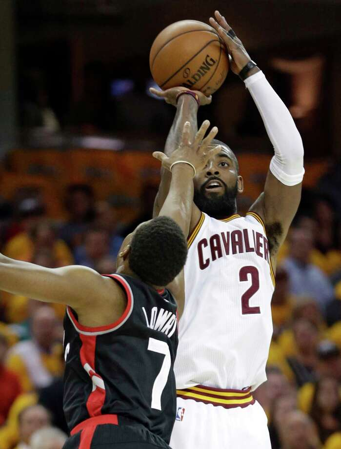 Cleveland Cavaliers' Kyrie Irving (2) shoots over Toronto Raptors' Kyle Lowry (7) in the first half in Game 1 of a second-round NBA basketball playoff series, Monday, May 1, 2017, in Cleveland. (AP Photo/Tony Dejak) ORG XMIT: OHTD110 Photo: Tony Dejak / AP 2016