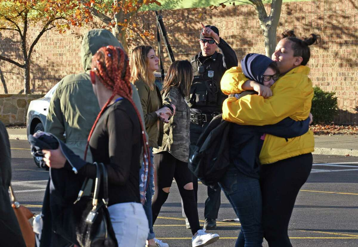 People are evacuated from Crossgates Mall after a possible shooting on Saturday Nov. 12, 2016 in Guilderland, N.Y. (Michael P. Farrell/Times Union)