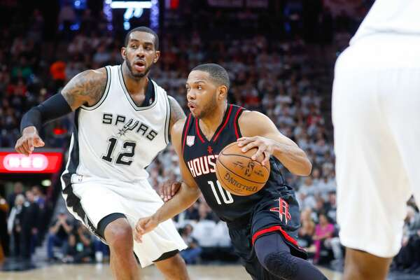 Houston Rockets guard Eric Gordon (10) drives past San Antonio Spurs forward LaMarcus Aldridge (12) during the first half of Game 1 of the second-round of the Western Conference NBA playoffs at AT&T Center,  Monday, May 1, 2017, in San Antonio. ( Karen Warren / Houston Chronicle )