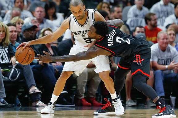 Rockets guard Pat Beverley, right, plays his usual pesky defense against veteran Spurs guard Tony Parker during the first half Monday night in San Antonio.