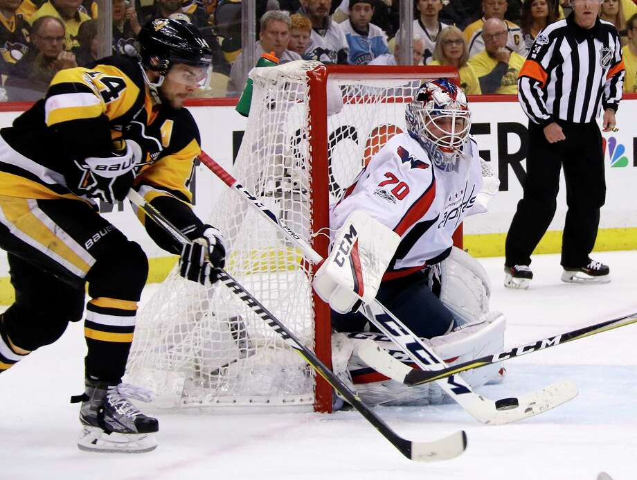 Washington Capitals goalie Braden Holtby (70) stops a shot by Pittsburgh Penguins' Chris Kunitz (14) during the second period of Game 3 in an NHL Stanley Cup Eastern Conference semifinal hockey game in Pittsburgh, Monday, May 1, 2017. (AP Photo/Gene J. Puskar) ORG XMIT: PAGP110 Photo: Gene J. Puskar / Copyright 2017 The Associated Press. All rights reserved.