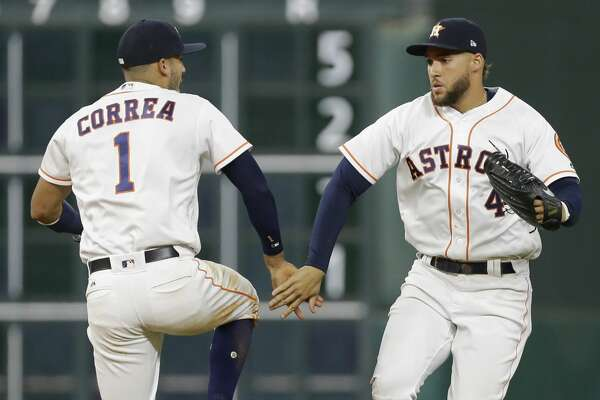 Houston Astros Carlos Correa and George Springer celebrate victory over Texas Rangers at Minute Maid Park Monday, May 1, 2017, in Houston. ( Melissa Phillip / Houston Chronicle )