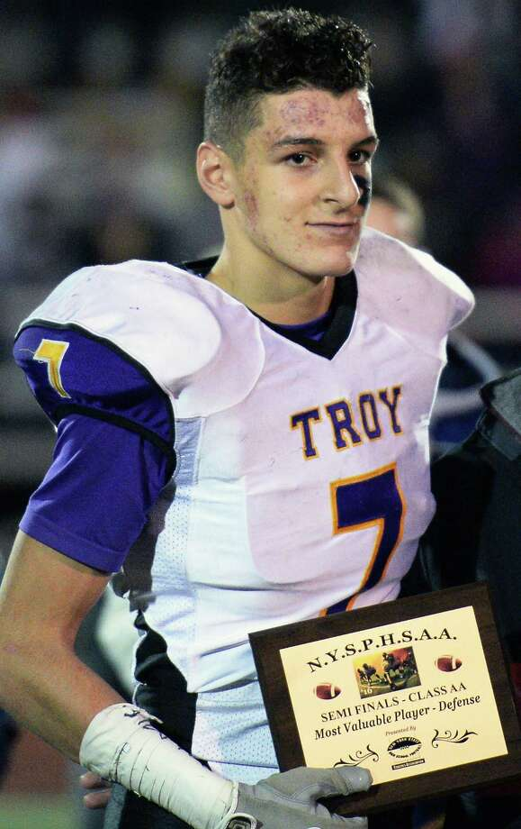 Troy #7 Joe Casale poses for photos after winning the most valuable defensive player after their win in the Class AA state semifinal game against New Rochelle at Dietz Stadium Saturday Nov. 19, 2016 in Kingston, NY.  (John Carl D'Annibale / Times Union) Photo: John Carl D'Annibale / 20038815A