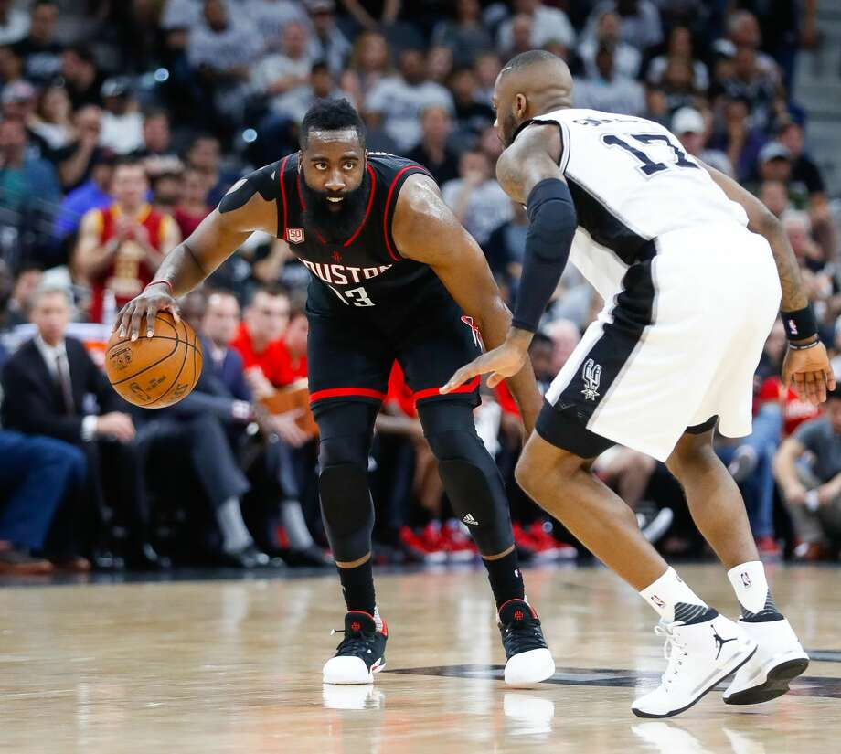 Houston Rockets guard James Harden (13) sizes up San Antonio Spurs guard Jonathon Simmons (17) during the second half of Game 1 of the second-round of the Western Conference NBA playoffs at AT&T Center,  Monday, May 1, 2017, in San Antonio. ( Karen Warren / Houston Chronicle ) Photo: Karen Warren/Houston Chronicle