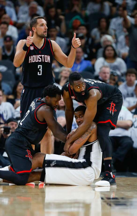 San Antonio Spurs forward LaMarcus Aldridge (12) tries to hold onto a loose ball during the second half of Game 1 of the second-round of the Western Conference NBA playoffs at AT&T Center,  Monday, May 1, 2017, in San Antonio. ( Karen Warren / Houston Chronicle ) Photo: Karen Warren/Houston Chronicle