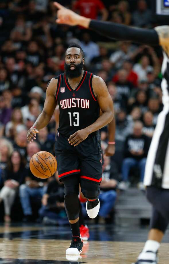 Houston Rockets guard James Harden (13) brings the ball down court during  the second