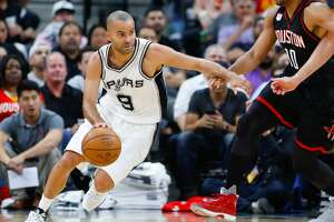 San Antonio Spurs guard Tony Parker (9) drives around Houston Rockets guard Eric Gordon (10) during the second half of Game 1 of the second-round of the Western Conference NBA playoffs at AT&T Center,  Monday, May 1, 2017, in San Antonio. ( Karen Warren / Houston Chronicle )