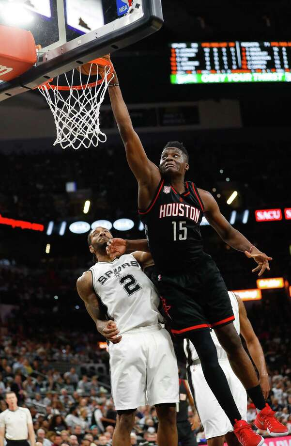 Whether it was outside with 22 3-pointers or center Clint Capela going 8 of 10 from close range while scoring 20 points, the Rockets had their way with Kawhi Leonard (2) and the Spurs on Monday night. Photo: Karen Warren, Staff Photographer / 2017 Houston Chronicle