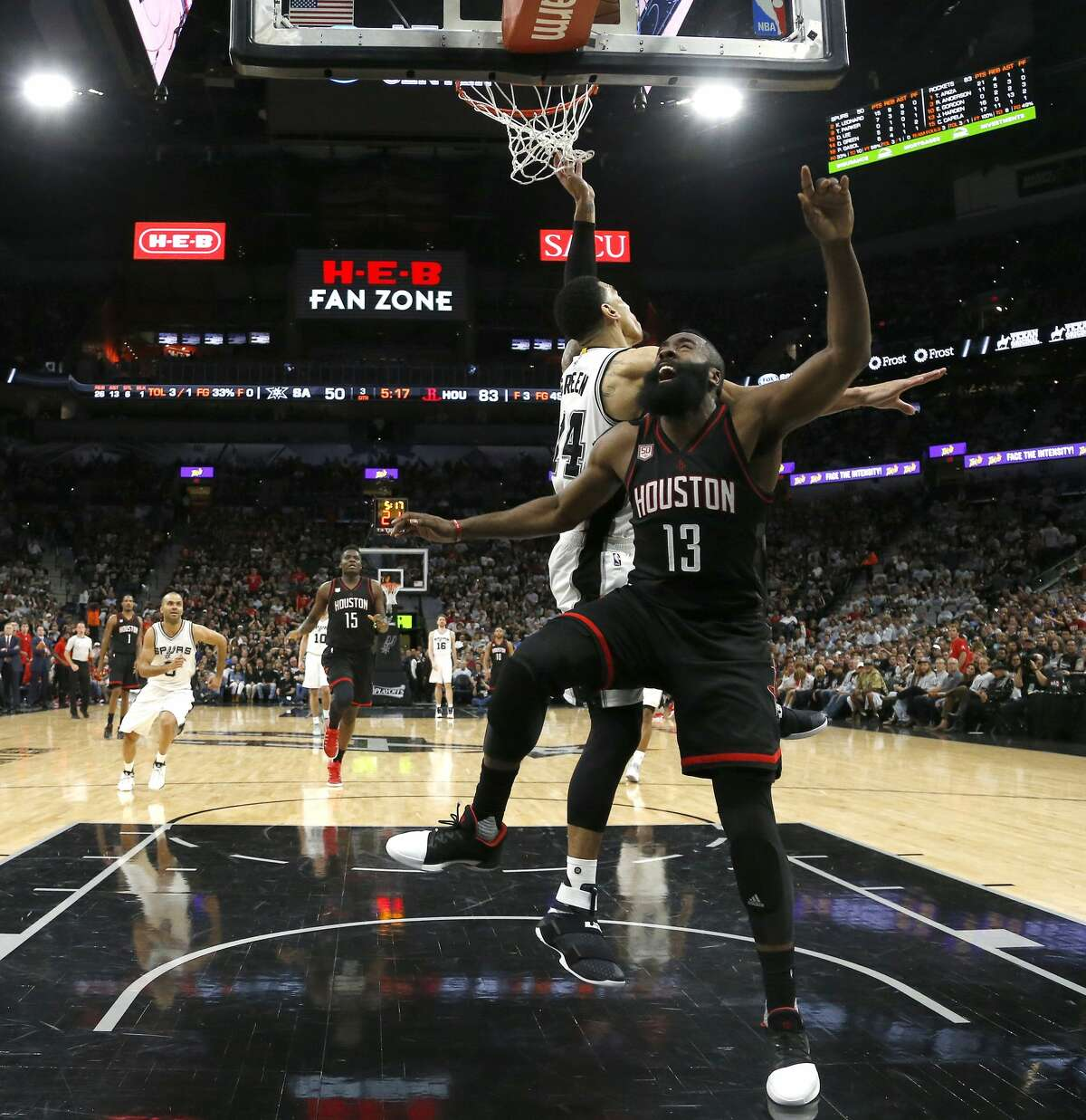 Houston Rockets guard James Harden (13) is fouled under the basket by San Antonio Spurs guard Danny Green (14) during the second half of Game 1 of the second-round of the Western Conference NBA playoffs at AT&T Center, Monday, May 1, 2017, in San Antonio. ( Karen Warren / Houston Chronicle )