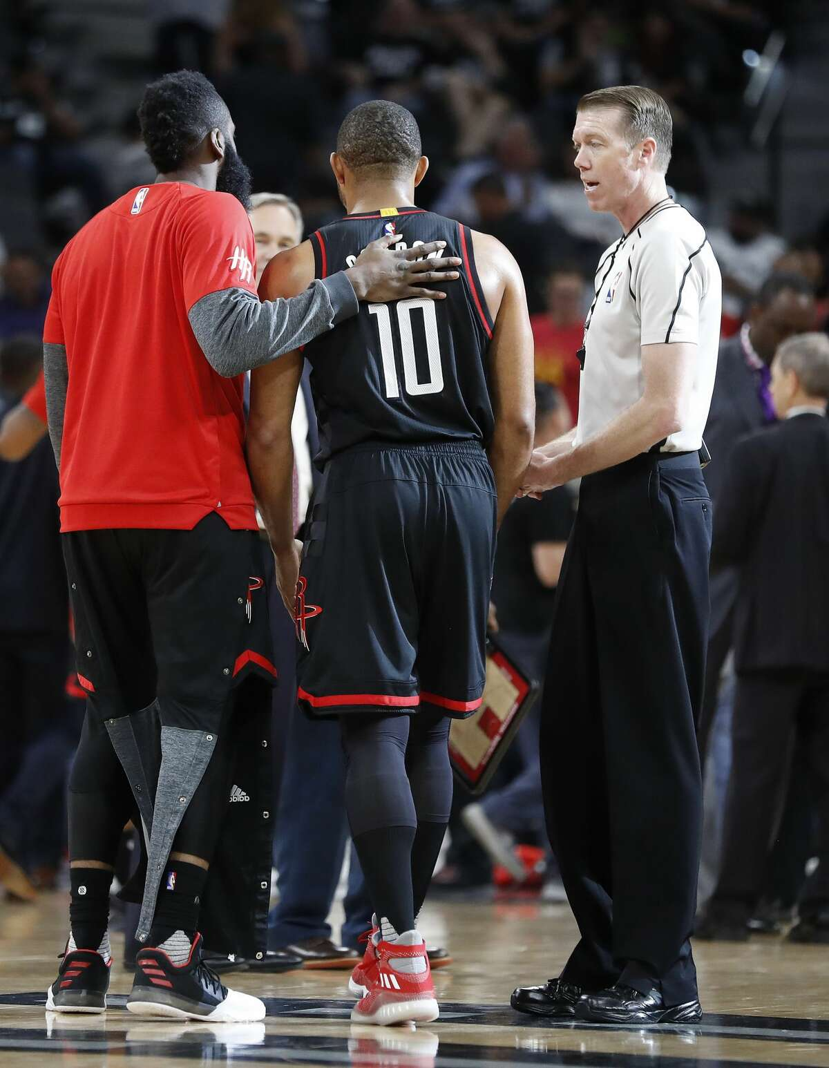Houston Rockets guard James Harden (13) moves Eric Gordon (10) back from the referee during the second half of Game 1 of the second-round of the Western Conference NBA playoffs at AT&T Center, Monday, May 1, 2017, in San Antonio. ( Karen Warren / Houston Chronicle )