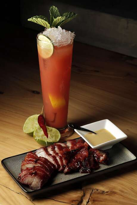 Kurobuta pork char siu, hot mustard with the Sweet and Sour Mischief cocktail at China Live in S.F. Photo: Carlos Avila Gonzalez, The Chronicle