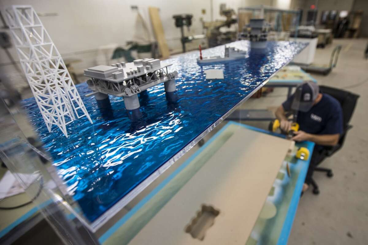 Ben Nikkel builds a model at USM Incorporated in preparation for the upcoming Offshore Technology Conference on Tuesday, April 25, 2017, in Houston. ( Brett Coomer / Houston Chronicle )