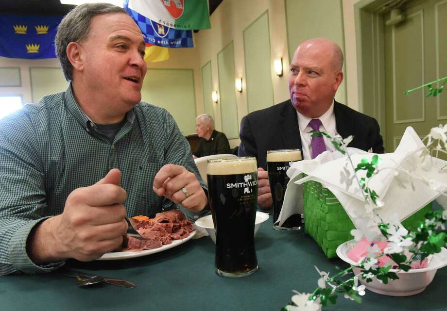 Bob Daley of Clifton Park, N.Y. (L) enjoys a Guinness beer in Albany during a St. Patrick's Day event. In 2017, Guinness brewer is eliminating isinglass from the production process for Guinness. ( Lori Van Buren / Times Union) Photo: Lori Van Buren / Albany Times Union / 20039976A