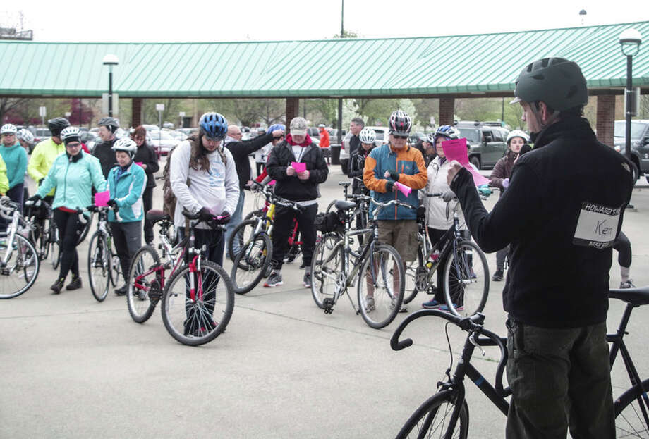 Photo provided Riders gather Saturday morning before the fifth annual Howard's Friend Bike Ride to participate in a Blessing of The Bicycles service at Midland's Farmers Market. / ©2016 Stuart Frohm
