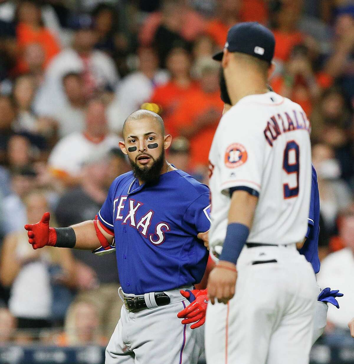 Rougned Odor #12 of the Texas Rangers has words with Marwin Gonzalez #9 of the Houston Astros after benches cleared in the sixth inning when Lance McCullers Jr. #43 of the Houston Astros threw a pitch behind Mike Napoli #5 at Minute Maid Park on May 1, 2017 in Houston, Texas. (Photo by Bob Levey/Getty Images)
