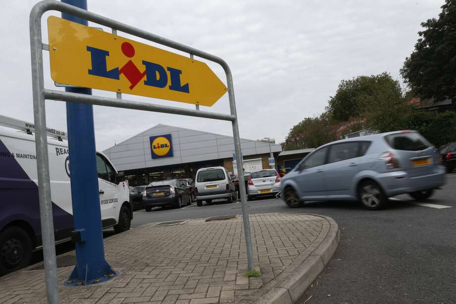 FILE - A logo is pictured on a sign outside a Lidl supermarket store in London on Sept. 26, 2016. The German grocery chain, one of the largest in the world, is planning to set up shop in Conroe, Texas as part of its American expansion. Photo: DANIEL LEAL-OLIVAS, AFP, Getty Images