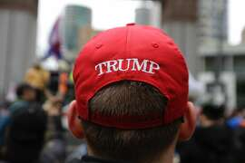 A supporter of President Donald Trump takes part in a May Day protest, Monday, May 1, 2017, in Seattle. (AP Photo/Ted S. Warren)