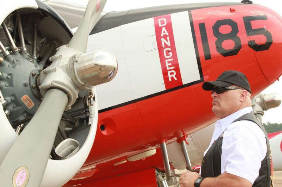 United 737 Captain Mike Jones served 12-years in the Marine Corp and appreciated the North American T-6 Texan at the inaugural U.S. Armed Forces Day Fly-In at Conroe-North Houston Regional Airport on May 21, 2016. Photo: File Photo By Meagan Ellsworth