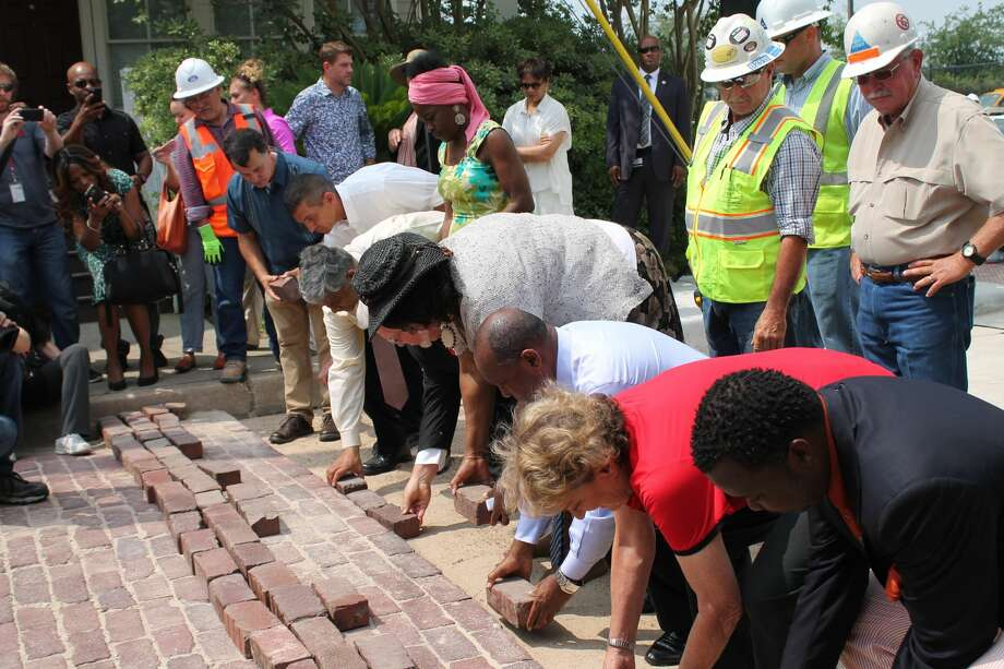Mayor Sylvester Turner lays a brick as part of a ceremony to kick off the re-installation of historic bricks made by freed slaves in Houston's Freedmen's Town on Friday, April 28, 2017. The following week it turned out many of the bricks were not original. (Courtesy of City of Houston) Photo: Courtesy Of City Of Houston