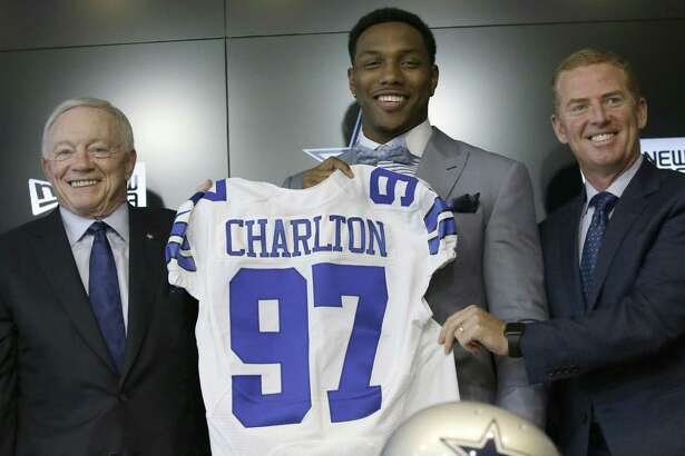 The Dallas Cowboys No. 1 draft pick defensive end Taco Charlton poses for a photos with team owner Jerry Jones and head coach Jason Garret during a news conference at the team's headquarters in Frisco on April 28, 2017.