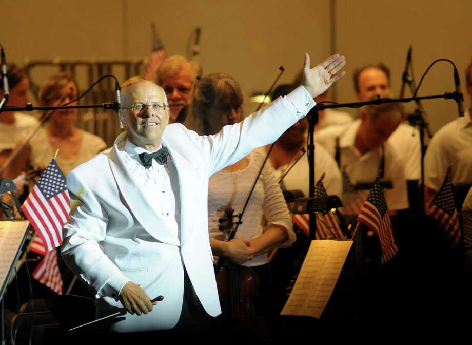 "Maestro Michael Krajewski's gave his final performance at the Pavilion Thursday in Houston Symphony's ""Bond & Beyond"" concert. / Ted Washington"