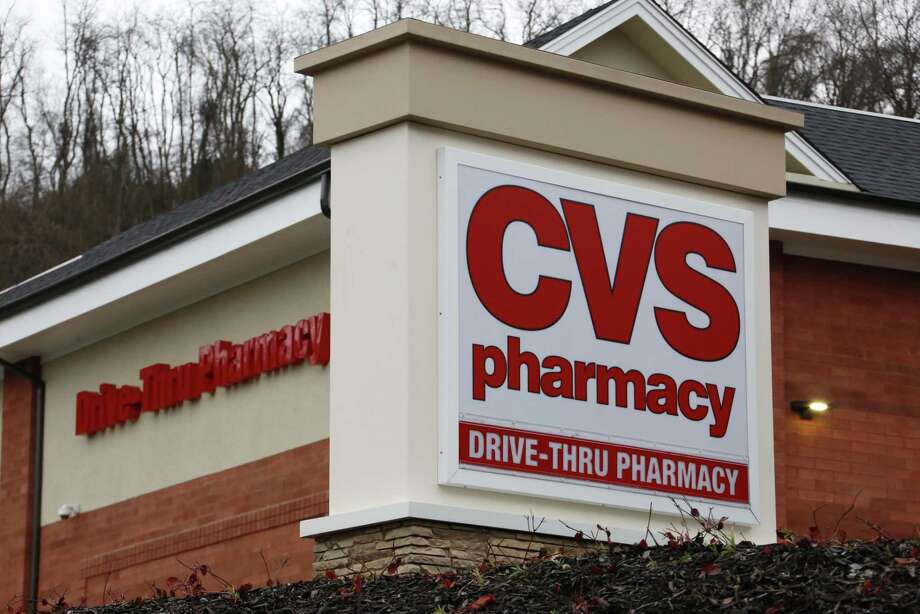 CVS Health reported that net income fell to $952 million in the quarter after its pharmacies were excluded from some prescription coverage networks. One big loss was the government's Tricare program, which provides coverage for military personnel and their families. CVS Health also saw a slump in sales outside the pharmacy area of its drugstores, but the company's pharmacy benefits management business helped counter that. Photo: Gene J. Puskar /Associated Press / Copyright 2017 The Associated Press. All rights reserved.