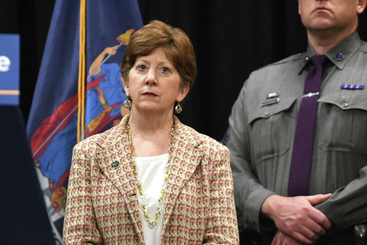 Mayor Kathy Sheehan listens as Gov. Andrew Cuomo makes an announcement on public safety initiatives during a press event at the Albany Public Library with and members of state and local law enforcement on Tuesday morning, May 2, 2017, in Albany, N.Y. (Will Waldron/Times Union)