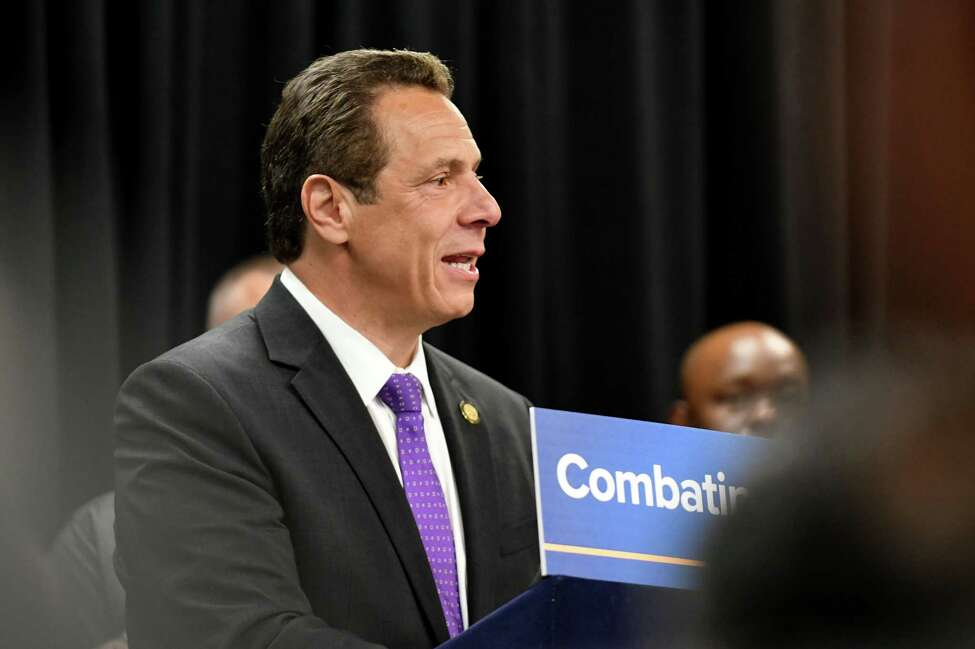 Gov. Andrew Cuomo makes an announcement on public safety initiatives during a press event at the Albany Public Library with Mayor Kathy Sheehan and members of state and local law enforcement on Tuesday morning, May 2, 2017, in Albany, N.Y. (Will Waldron/Times Union)