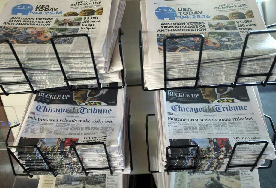 Three-quarters of newspaper subscribers say they primarily read the product in print, while 21 percent said they see it online, according to a study. News executives can't afford to focus on one type of consumer at the expense of another, says Tom Rosenstiel, executive director of the American Press Institute. Photo: Associated Press File Photo / Copyright 2016 The Associated Press. All rights reserved. This material may not be published, broadcast, rewritten or redistribu