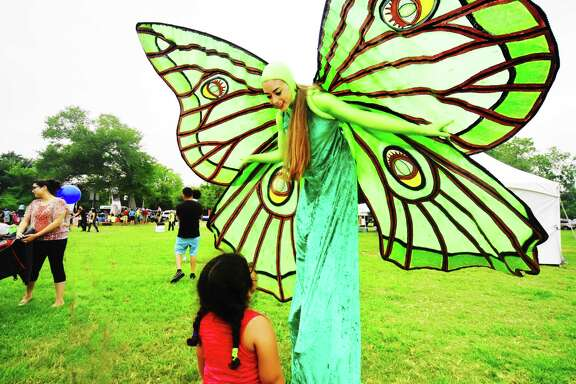 Kaylen Gonzalez  is dressed as a butterfly and was admired by Emma Rodrigues at the 10th Annual Nature Fest in Bridgeland.