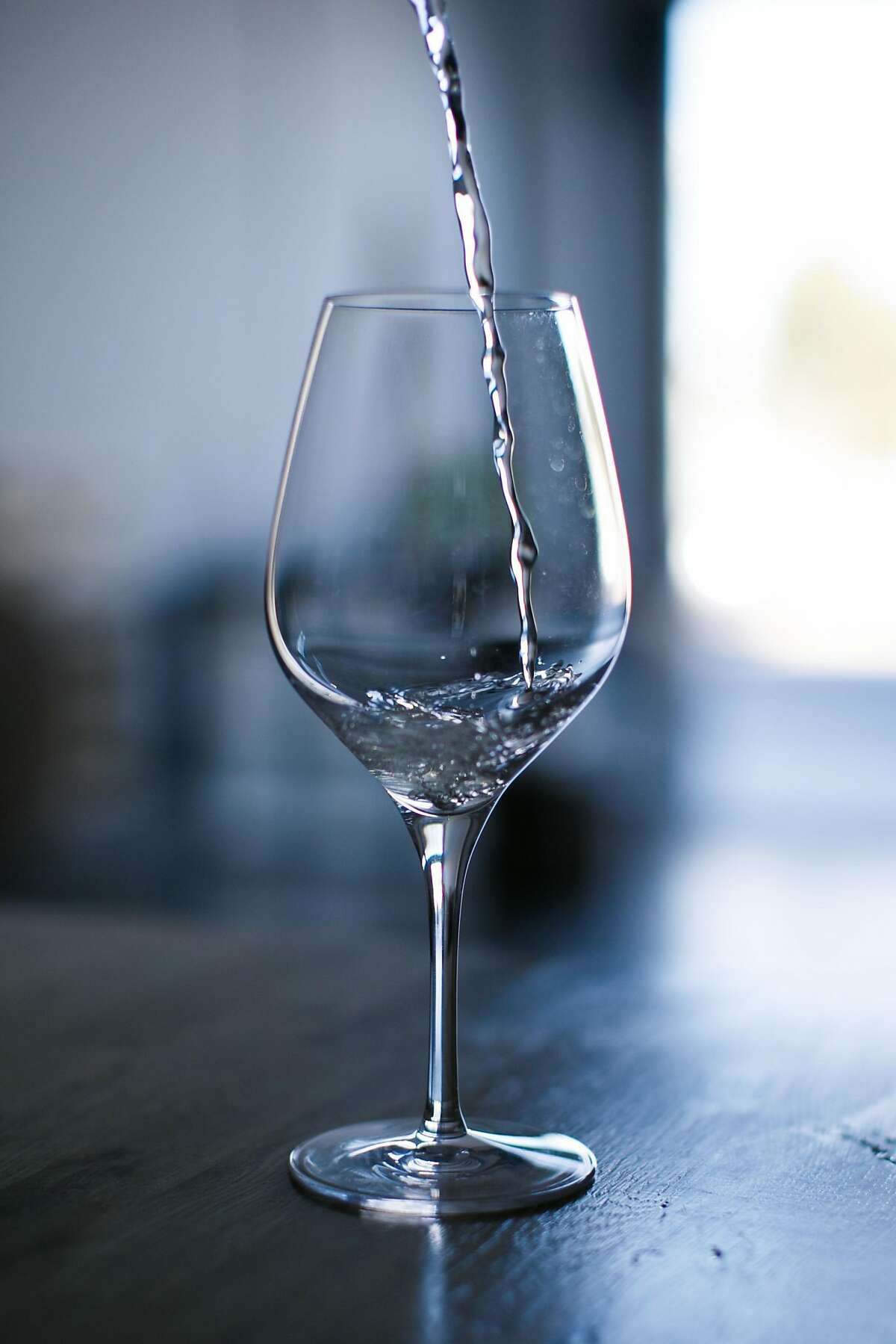 A Moscato prototype poured into a glass at Ava Winery's lab in San Francisco.