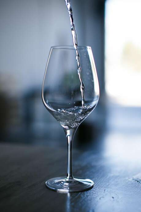 A Moscato prototype poured into a glass at Ava Winery's lab in San Francisco. Photo: Mason Trinca, Special To The Chronicle